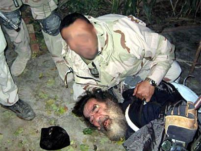 القاء القبض على صدام حسين في مثل هذا اليوم (13/12/2003) ماذا يعني لكم وما هي حصيلة حكمه (بلا سب او قذف رجاءً) Saddam