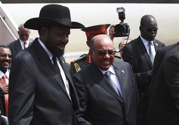 أحداث جارية  - صفحة 2 Sudan_s_president_omar_hassan_al-bashir_c_meets_his_south_sudan_counterpart_salva_kiir_l_upon_his_arrival_at_the_juba_airport_in_south_sudan_april_12_2013._reuters-b5146