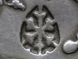 Resello de corazón con tres puntos sobre marcaco de 2 reales. Sumanep_detail_Shield-lily_cross_small