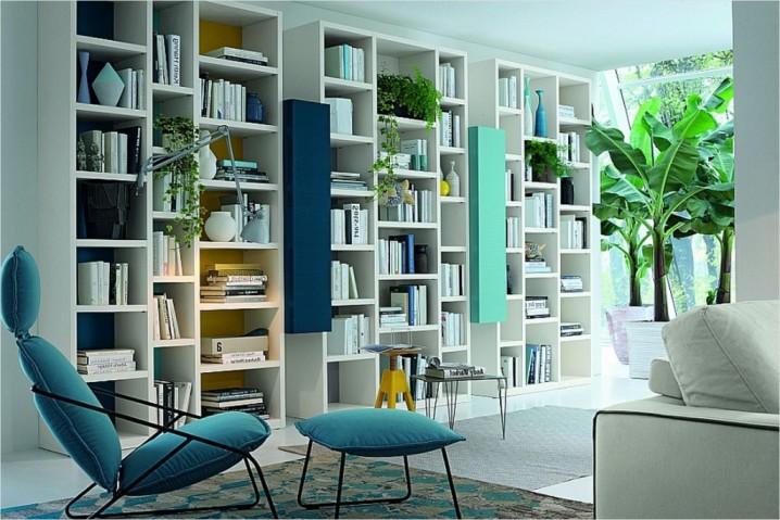 غرفة المعيشة Cool-Colors-Everyday-wall-unit-looks-for-elegant-italian-living-room-design-combined-with-creative-wall-units-also-modern-armchair-with-footstools-near-white-sofas-as-well-as-banana-tree-on-the-huge-vase-1024x683-718x479