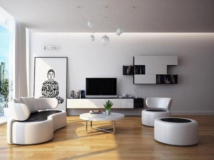 غرفة المعيشة Minimalist-living-room-round-couch-design-white-wall-mounted-modern-book-shelves-wall-mounted-tv-stand-white-floating-multimedia-cabinet-black-white-back-rest-modern-shape-couch-black-white-back-rest-718x539