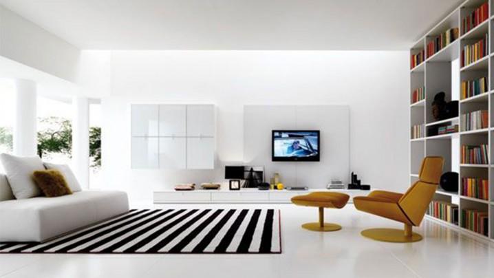 غرفة المعيشة Modern-living-room-with-brown-armchair-design-and-white-leather-sofa-and-white-living-room-walls-and-bookshelf-design-718x404
