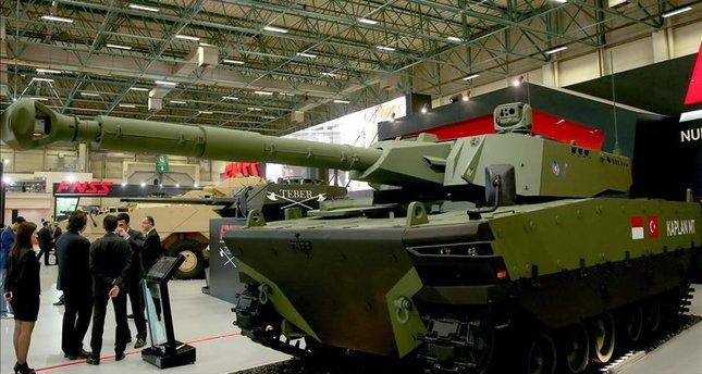 تركيا تكشف عن الدبابه Kaplan MT لأول مرة خلال معرض إسطنبول للصناعات الدفاعية - صفحة 2 645x344-turkish-indonesian-made-battle-tank-unveiled-in-istanbul-1494445892654
