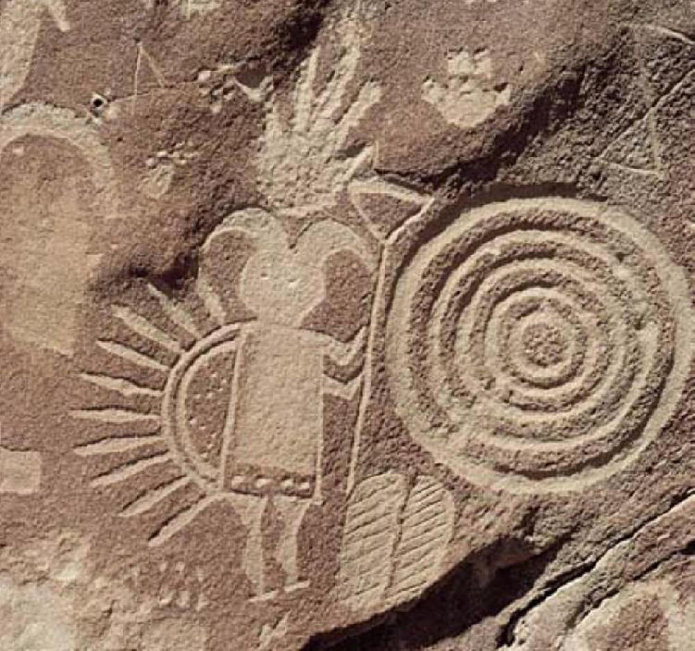 So 2012 was a fake, eh? - Page 3 Devil-blocking-out-the-sun-next-to-a-spiral-petroglyph1