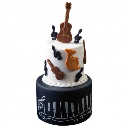 Feliz cumpleaños papyguitarra  .gateau_anniversaire_musicien_faire_un_gateau_sur_theme_musique_avec_instruments_en_pate_a_sucre_emporte_piece_m