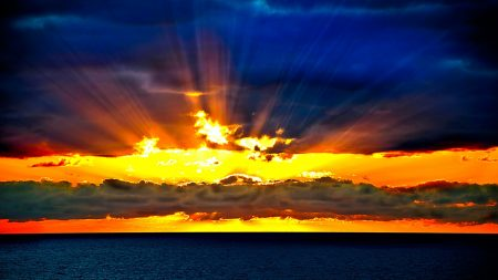 Weird sky beam Sun_beams_sky_horizon_sea_orange_decline_26659_1920x1080-450x253