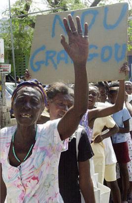 Pour une Prolongation de la Misère et les Taudis en Haiti - Page 3 Feb_11_2003_b