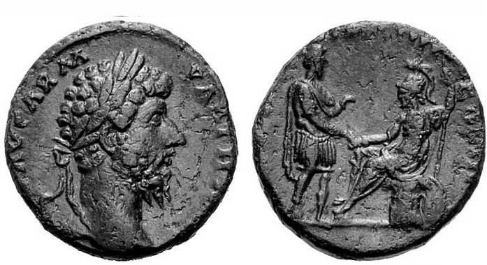 As de Lucio Vero. Roma sentada,entregando su mano a Lucio Vero.  RIC_1472