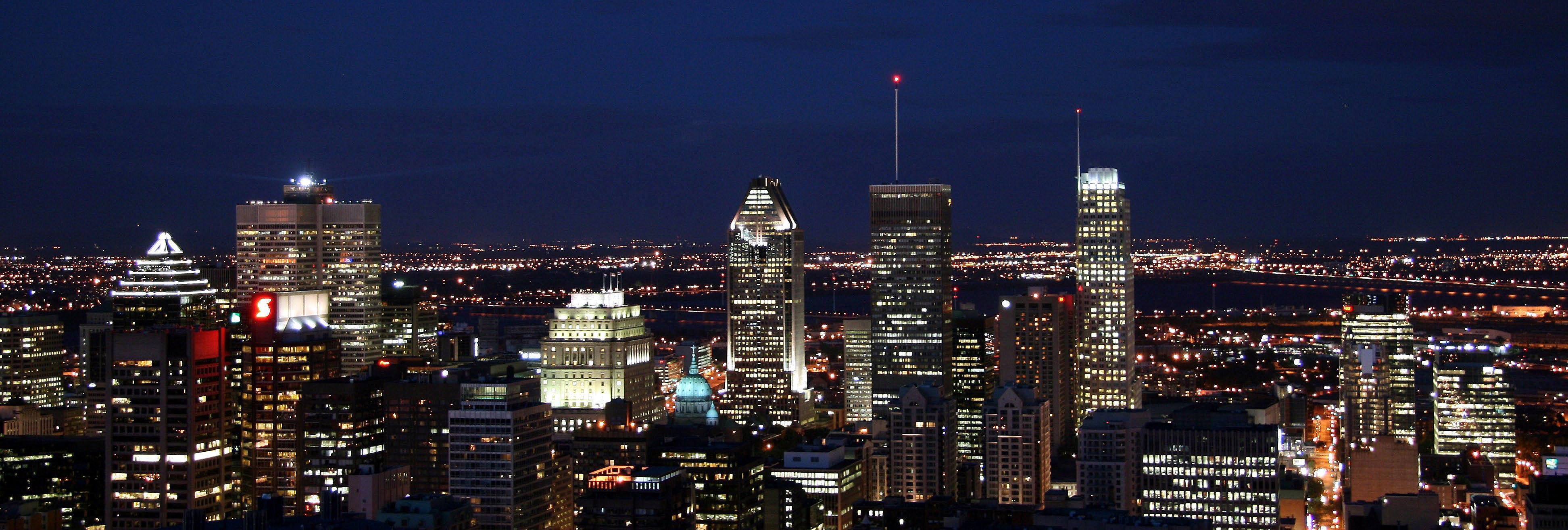 கனடா Montreal_skyline_night