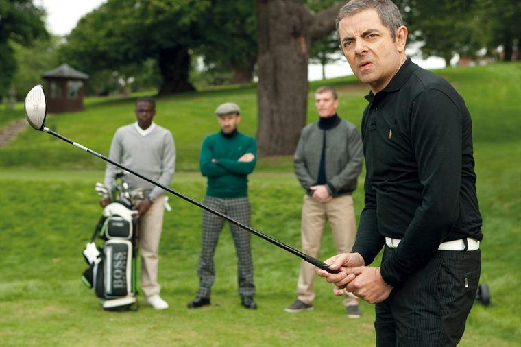 [Jeu] Suite d'images !  - Page 2 Rowan-atkinson-au-golf