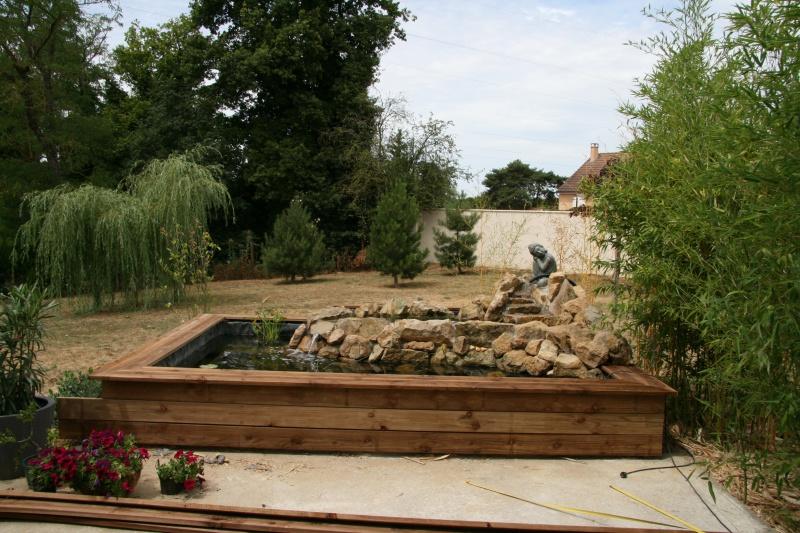 bassin 5/6 m3 semi enterré avec cascade et déversoir 130638IMG2928