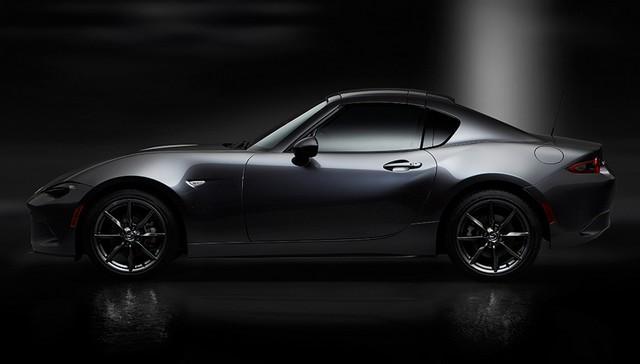 Salon de l'auto de New York : première mondiale de la Mazda MX-5 RF  94595212MazdaMX5RFshowmodelSidecloseblack