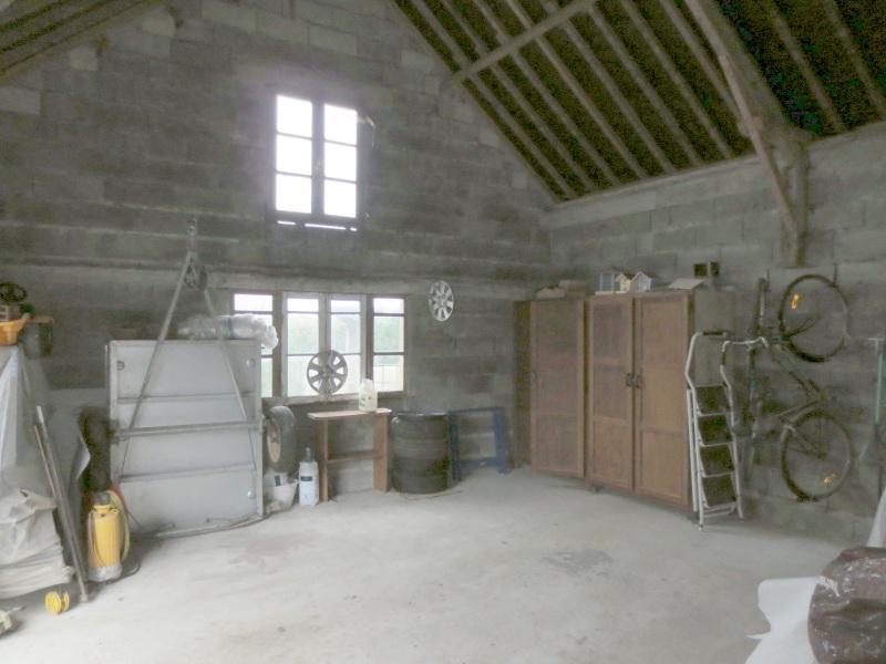 Faire d'un grand garage un atelier !  514797Garage1