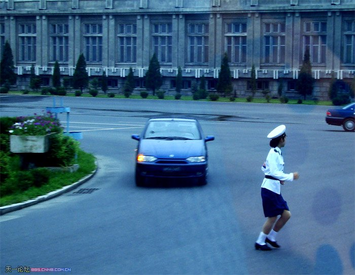 PYONGYANG TRAFFIC GIRL TRYING TO AVOID BEING RUN OVER BY A CAR !! Ish_1410